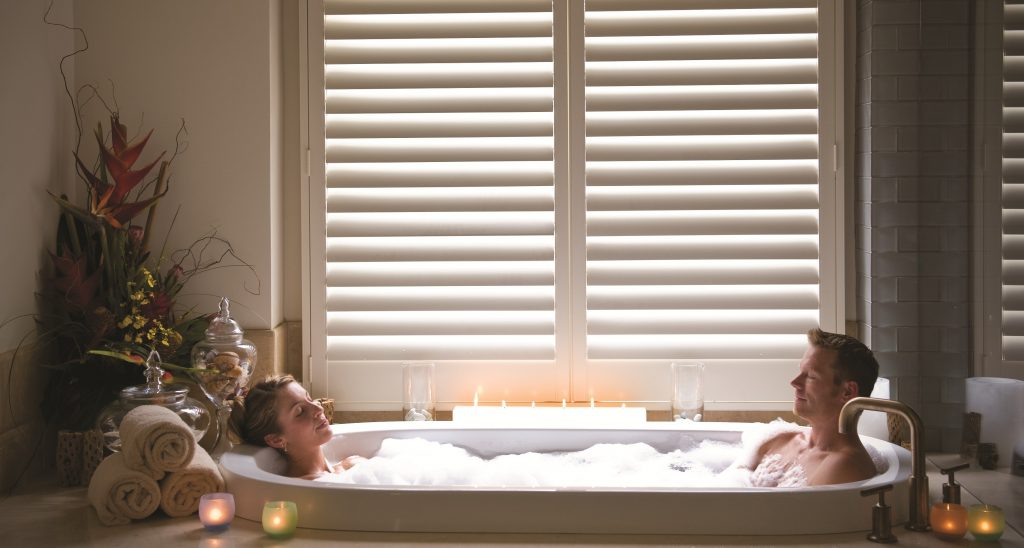 Couple enjoying private bath for two at Spa on the Plaza