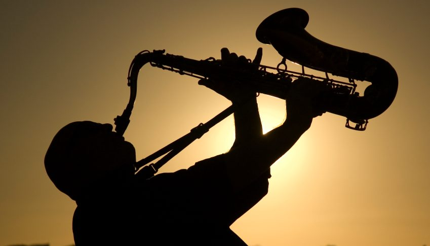 A saxophonist playing on the beac in Famara in Lanzarote