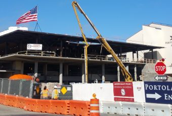American flag signifying the steel works is complete