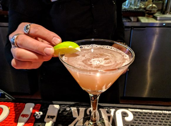 Garnishing CC's Rumtini with a lime wedge