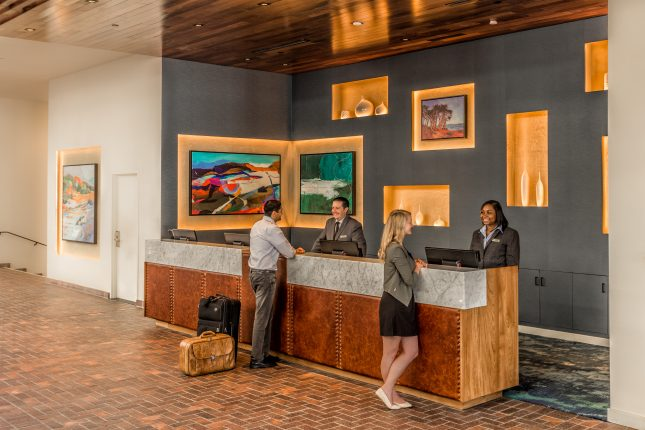 Travelers checking in a Portola Hotel