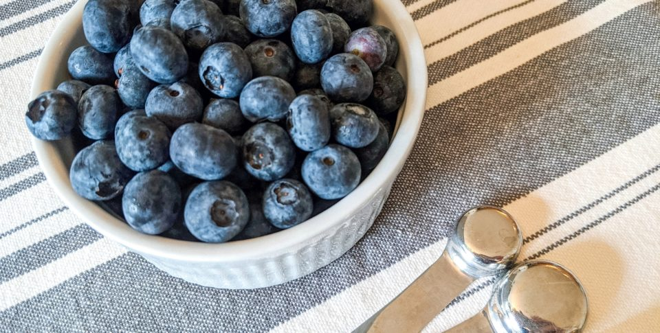 Blueberries and measuring spoons