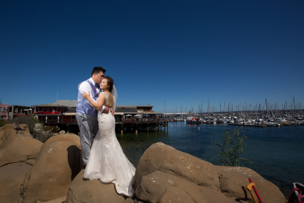 Bride and groom by the wharf